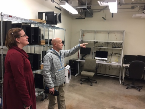 Chemistry department administrator Brenna Goode and Core IT Facilities manager Jerry Protheroe visit a reclaimed server room in the Chemistry Building. The department's IT staff currently use the room as expansion and storage space.