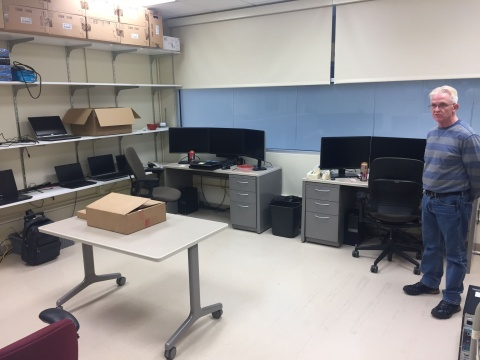 College of Public Health systems administrator Gary Hulett in the new work room for student IT staff at the University Capitol Center. The servers that once filled the room have been virtualized or relocated to secure data centers.