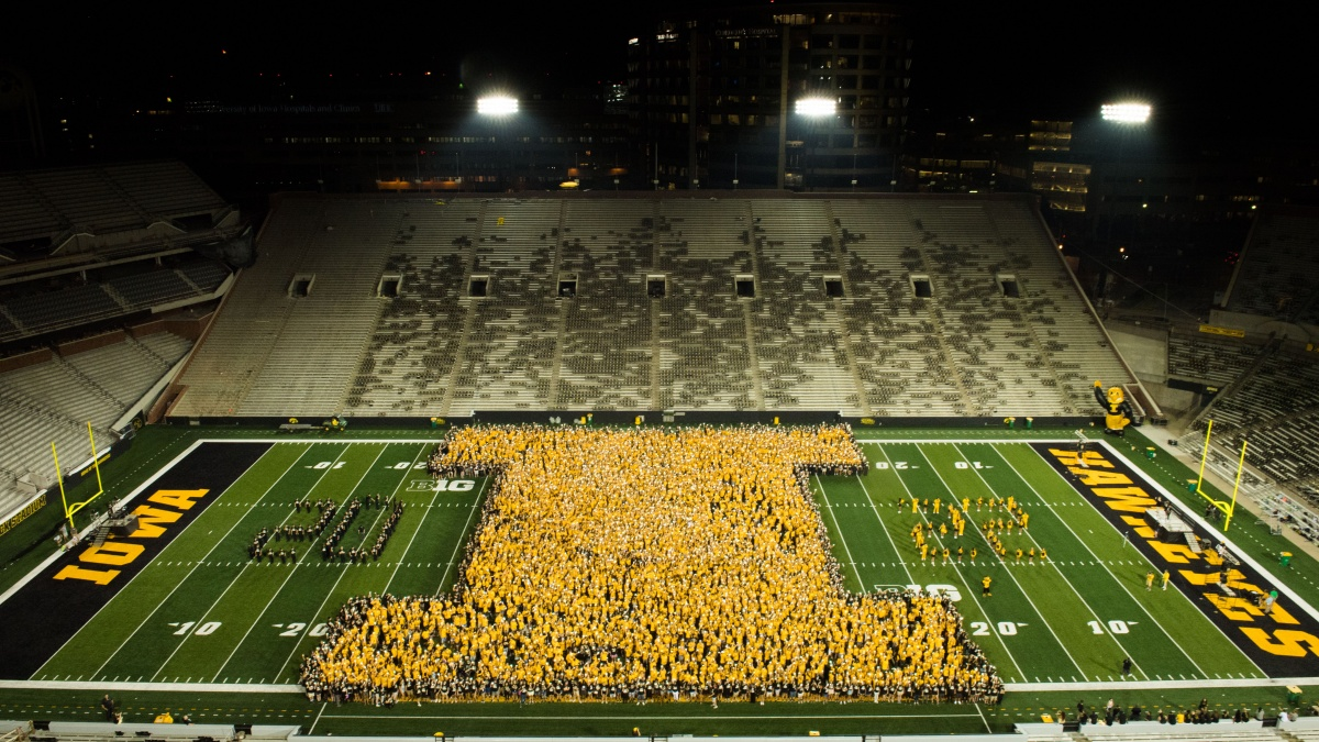 Students on field of Kinnick Stadium for OnIowa!